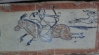 Brick painting at an underground ancient tomb.